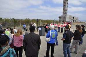 News conference in front of partially constructed FAA air traffic control tower