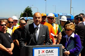 Port of Oakland Executive Director Omar R. Benjamin speaking at an Oakland International Airport press conference with U.S. Senator Barbara Boxer to urge Congress to provide a speedy and long-term resolution to the FAA crisis.