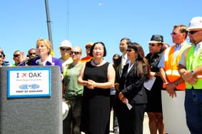 U.S. Senator Barbara Boxer speaking at Oakland International Airport with Oakland Mayor Jean Quan, Port Commission President Pamela Calloway, Port Commissioner Victor Uno, Alameda Labor Council Executive Secretary-Treasurer Josie Camacho along with dozens of other community and labor leaders.