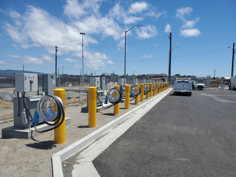 Photo of ten, new electrical charging stations for battery electric drayage trucks.